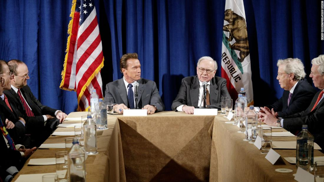 Buffett joins California Gov. Arnold Schwarzenegger during a meeting of Wall Street investors in New York in 2004. Buffett advised Schwarzenegger's gubernatorial campaign in 2003.