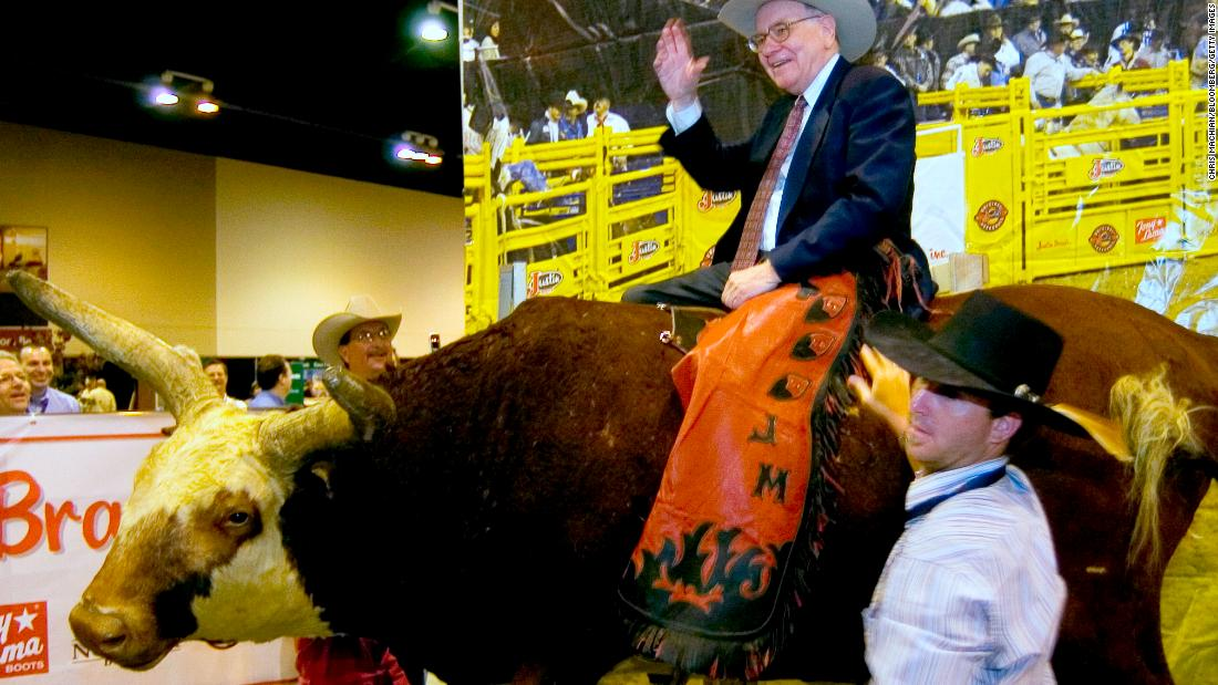 Buffett sits atop a fake bull at the Berkshire Hathaway annual meeting in 2006.