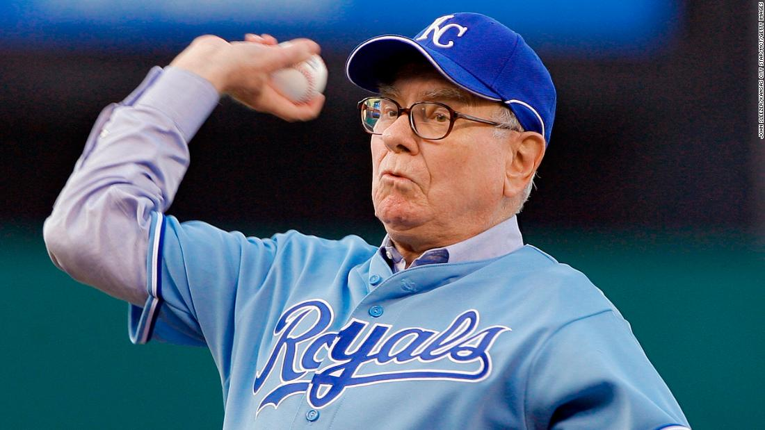 Buffett throws out the first pitch before a Kansas City Royals baseball game in 2008.