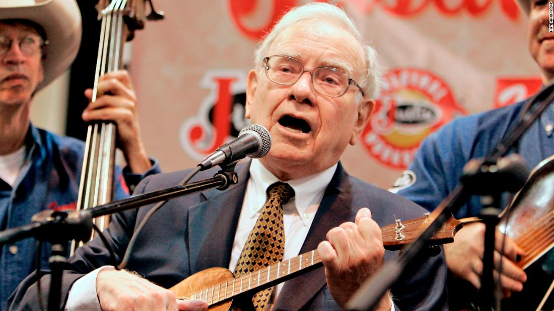 Buffett plays the ukulele with a band during the Berkshire Hathaway meeting in 2007. He learned the instrument decades ago.