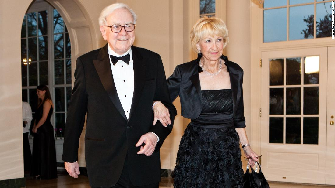 "Buffett and his second wife, Astrid, arrive at the White House for a state dinner honoring British Prime Minister David Cameron in 2012. The next month, Buffett confirmed that he had been diagnosed with Stage 1 prostate cancer. He underwent radiation treatments and told Berkshire Hathaway shareholders that the cancer was ""not remotely life-threatening."""