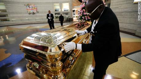 Vincent Street wipes down Franklin's casket during a public viewing this week at a Detroit museum.
