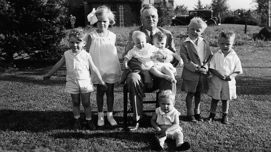 A young Buffett, far left, is seen with his grandfather, Ernest, as well as his cousins and two sisters.