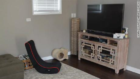 A rocking chair sits in front of a television in the Hart family's home.