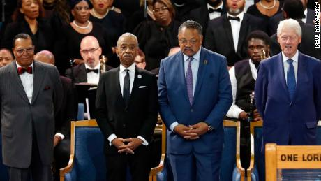 From left, Louis Farrakhan, the Revs. Al Sharpton and Jesse Jackson and former President Bill Clinton.