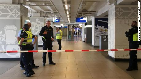 Security officials cordon off an area inside Amsterdam's central railway station Friday after the stabbings.