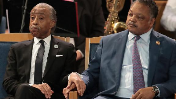 From left, Louis Farrakhan, the Rev. Al Sharpton and the Rev. Jesse Jackson attend Franklin