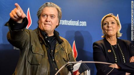 Steve Bannon, left, with France's far-right leader Marine Le Pen after giving a speech at her party's annual congress on March 10, 2018 in Lille, France.