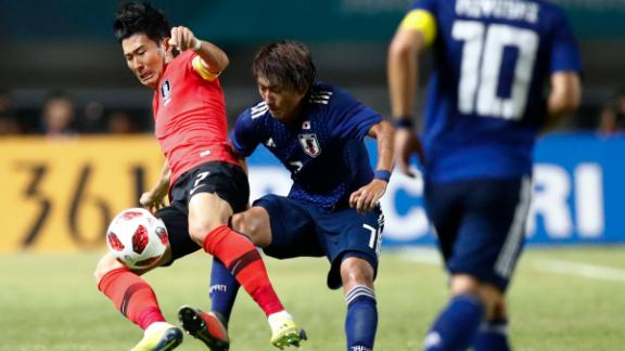 South Korea's Son Heung-min, left, duels for the ball against Japan's Teruki Hara during Saturday's match.