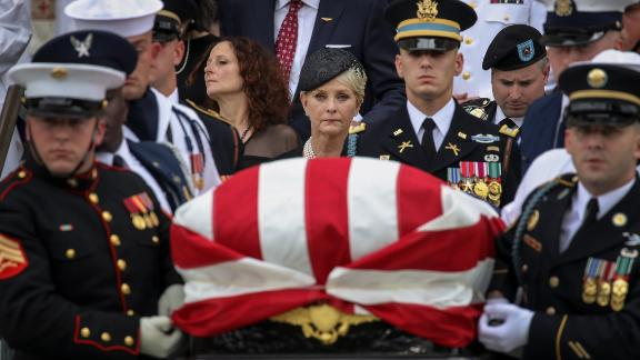 WASHINGTON, DC - SEPTEMBER 1: Cindy McCain looks on as a joint military service casket team carries the casket of the late Senator John McCain following his funeral service at the Washington National Cathedral, September 1, 2018 in Washington, DC. Former presidents Barack Obama and George W. Bush delivered eulogies for McCain in front of the 2,500 invited guests. McCain will be buried on Sunday at the U.S. Naval Academy Cemetery. (Photo by Drew Angerer/Getty Images)