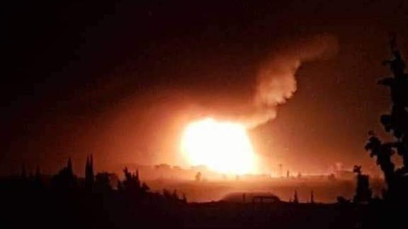 Another image from social media shows an explosion late Saturday in al-Mazzeh.