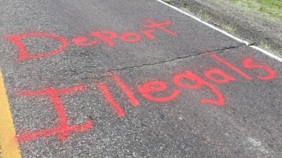 The spray-painted message appeared on the road Thursday.