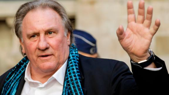 French actor Gerard Depardieu waves as he arrives at the Town Hall  in Brussels for a ceremony as part of the 'Brussels International Film Festival' (Briff) on June 25, 2018. (Photo by THIERRY ROGE / BELGA / AFP) / Belgium OUT