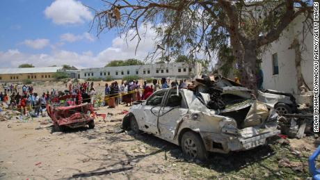 People inspect damage around the site after an attack carried out with a bomb-laden vehicle on September 02, 2018, in Mogadishu, Somalia.
