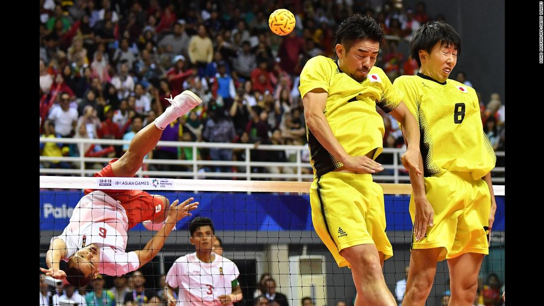 Japan's Takeshi Terashima, second left, and Hirokazu Kobayashi, right, defend against Indonesia's Nofrizal in the sepak takraw (kick volleyball) men's quadrant final on Saturday, September 1.