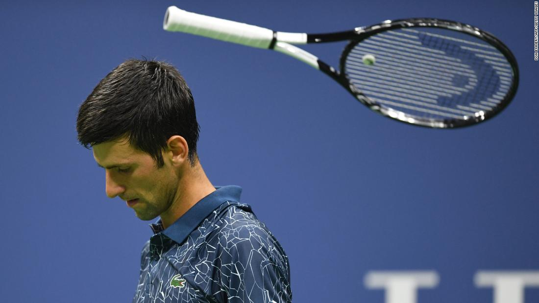 Serbia's Novak Djokovic tosses his racket while playing against Tennys Sandgren of the United States during the US Open on Thursday, August 30.