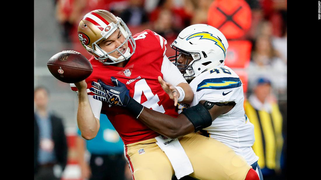 San Francisco 49ers quarterback Nick Mullens fumbles as he is sacked by Los Angeles Chargers defensive end Chris Landrum during the first half of an NFL preseason football game on Thursday, August 30.
