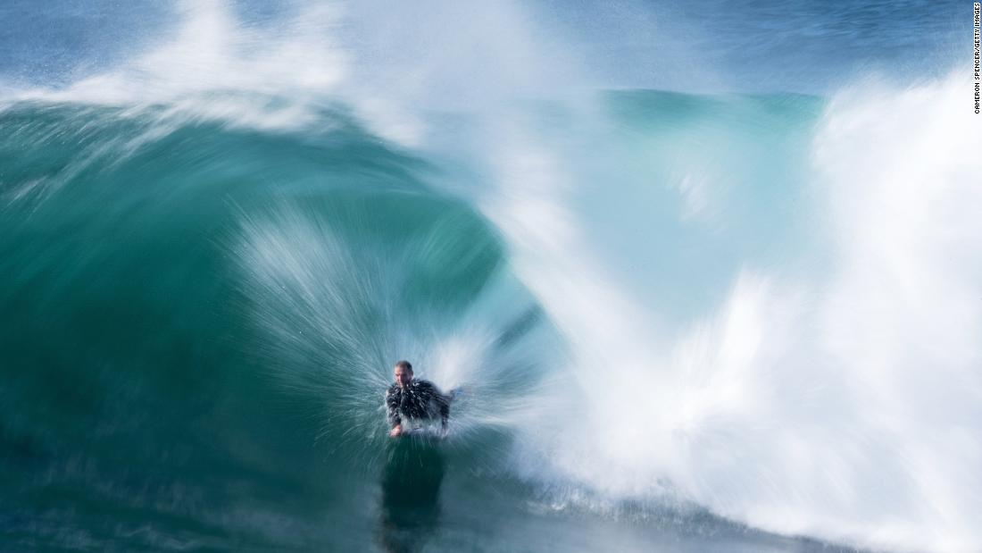 Toby Player rides a wave at Cape Solander in the Kamay Botany Bay National Park as a large swell hits the east coast of Australia on Thursday, August 30.
