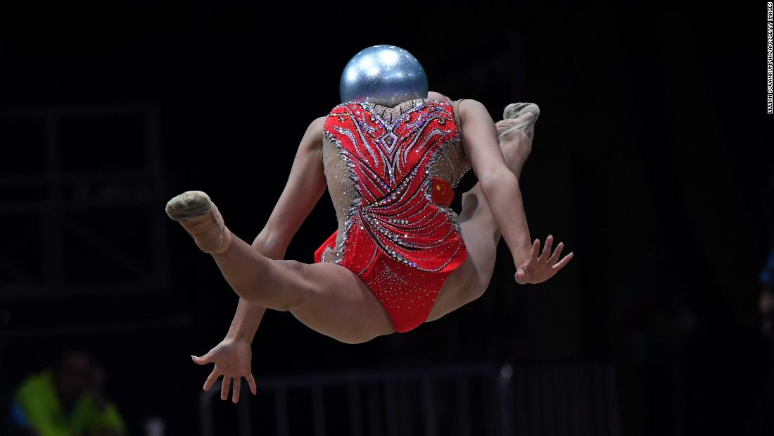 China's Zhao Yating competes with the ball in the women's rhythmic gymnastics individual all-around event at the Asian Games on Tuesday, August 28.