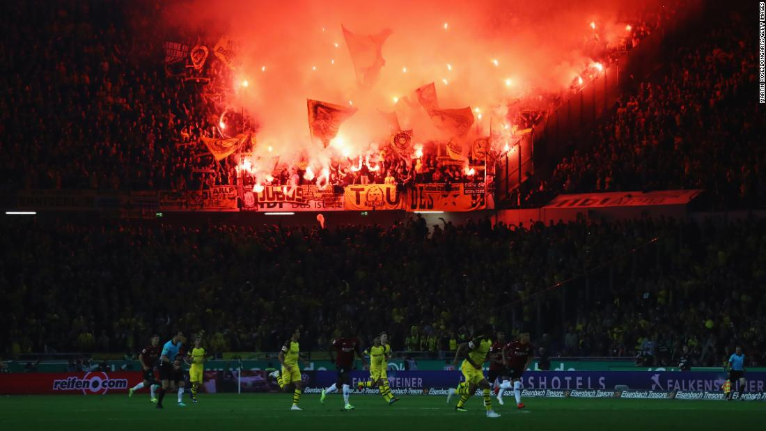 Borussia Dortmund fans light flares during the Bundesliga match with Hannover 96 on Friday, August 31.
