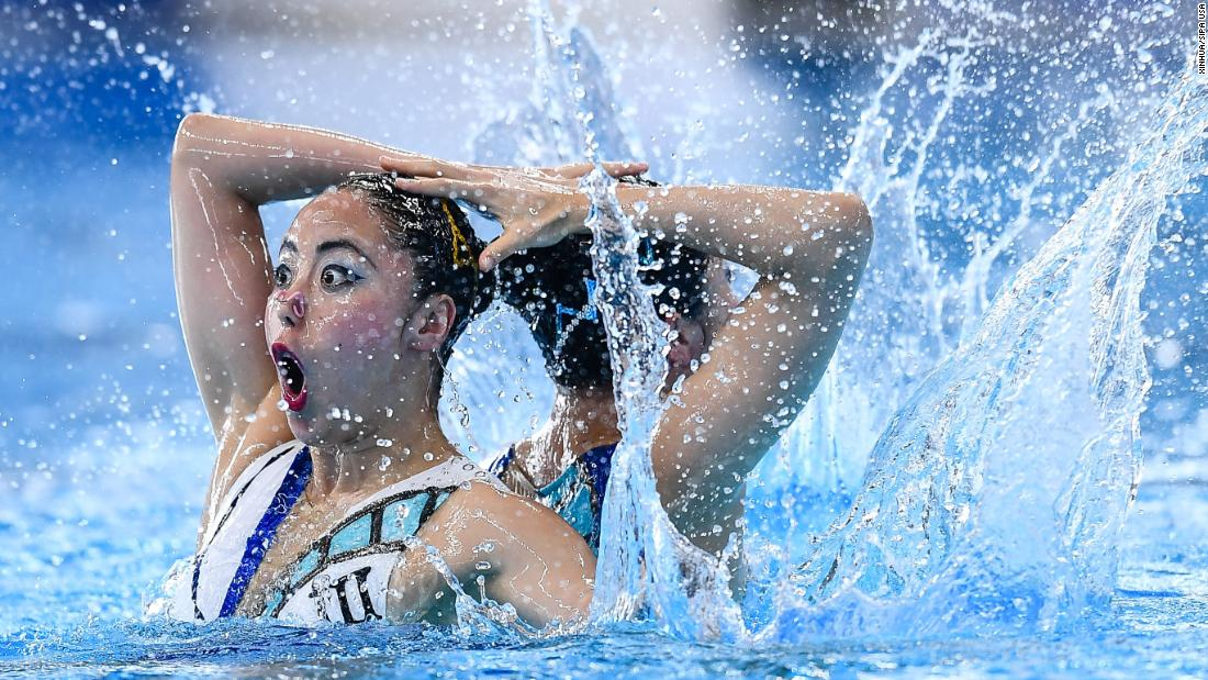 Japan's Inui Yukiko and Yoshida Megumu compete during the synchronized swimming duets on Tuesday, August 28.