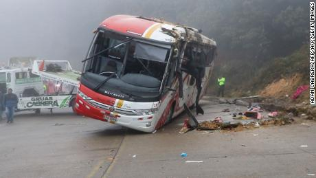 View of the overturned bus that crashed in the Cuenca - Loja route, 21 kilometers south of the city of Cuenca, in Ecuador on September 1, 2018. - A bus crash in Ecuador's Andes mountains left 11 people dead, authorities said Saturday, bringing the country's death toll from such accidents to 45 in the past three weeks. (Photo by Adan CABRERA / AFP) / The erroneous mention[s] appearing in the metadata of this photo by HO has been modified in AFP systems in the following manner: [Adan Cabrera] instead of [Cuenca Fire Department]. Please immediately remove the erroneous mention[s] from all your online services and delete it (them) from your servers. If you have been authorized by AFP to distribute it (them) to third parties, please ensure that the same actions are carried out by them. Failure to promptly comply with these instructions will entail liability on your part for any continued or post notification usage. Therefore we thank you very much for all your attention and prompt action. We are sorry for the inconvenience this notification may cause and remain at your disposal for any further information you may require.        (Photo credit should read ADAN CABRERA/AFP/Getty Images)