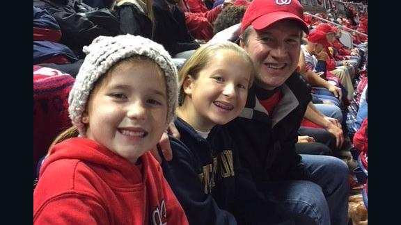 Judge Brett Kavanaugh with his daughters at Game 5 of the 2017 National League Division Series between the Chicago Cubs and Washington Nationals on October 12, 2017.