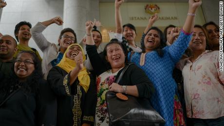 Transgender activists celebrate outside the court of appeals in Putrajaya in 2014, when three Malaysian transgender women on November 7 won their landmark bid to overturn an Islamic anti-cross dressing law.