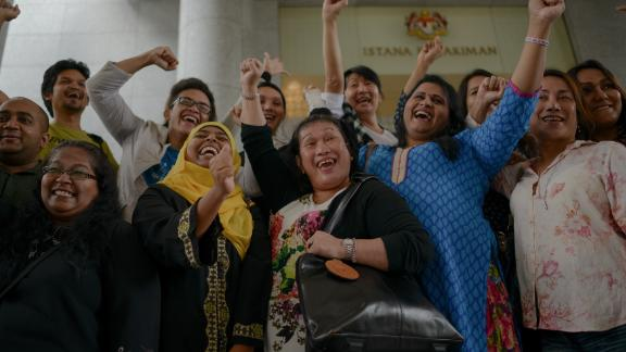 Transgender activists celebrate outside the court of appeals in Putrajaya in 2014, when three Malaysian transgender women on November 7 won their landmark bid to overturn an Islamic anti-cross dressing law.