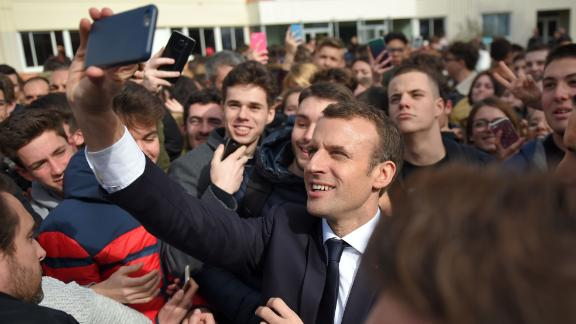 French President Emmanuel Macron takes a selfie picture with students during a visit at the high school Therese Planiole, in Loches, central France, as part of a trip to Indre-et-Loire on the theme of Education and professional training, on March 15, 2018.  / AFP PHOTO / POOL / GUILLAUME SOUVANT        (Photo credit should read GUILLAUME SOUVANT/AFP/Getty Images)
