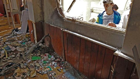 A young Libyan man inspects the interior of a mosque in Benghazi on February 9, 2018, after it was hit in a twin bomb attack.