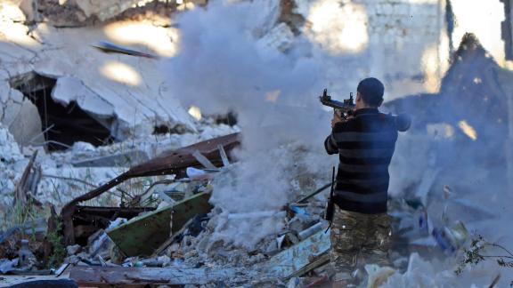 A member of the self-styled Libyan National Army, loyal to Khalifa Haftar, fires a rocket in Benghazi on November 9, 2017.