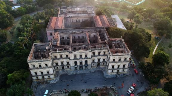 Drone view of Rio de Janeiro's treasured National Museum, one of Brazil's oldest, on September 3, 2018, a day after a massive fire ripped through the building. - The majestic edifice stood engulfed in flames as plumes of smoke shot into the night sky, while firefighters battled to control the blaze that erupted around 2230 GMT. Five hours later they had managed to smother much of the inferno that had torn through hundreds of rooms, but were still working to extinguish it completely, according to an AFP photographer at the scene. (Photo by Mauro Pimentel / AFP)        (Photo credit should read MAURO PIMENTEL/AFP/Getty Images)