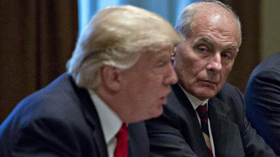 John Kelly, White House chief of staff, listens as U.S. President Donald Trump, left, speaks during a briefing with senior military leaders in the Cabinet Room of the White House in Washington, D.C., U.S., on Thursday, Oct. 5, 2017. Defense Secretary Jim Mattis said this week the U.S. and allies are holding the line against the Taliban in Afghanistan as forecasts of a significant offensive by the militants remain unfulfilled. Photographer: Andrew Harrer/Bloomberg via Getty Images