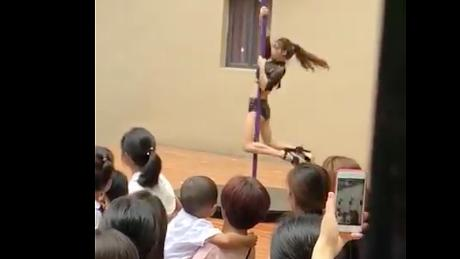 A pole dancing display put on in front of children and parents at a Chinese kindergarten in Shenzhen on Monday, September 3.