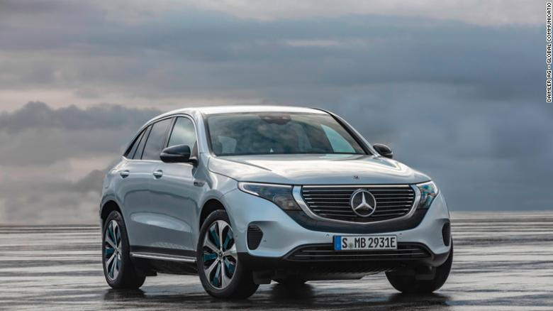 The Mercedes-Benz EQC is differentiated by a black band running under the grill and a bar of white light above it.