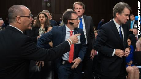 Fred Guttenberg, father of Parkland, Florida, shooting victim Jaime Guttenberg, tries to speak with then-Judge Brett Kavanaugh as he leaves for a break during his Senate confirmation hearing in 2018.