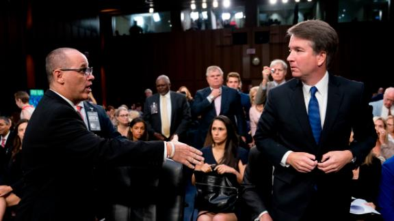 Fred Guttenberg, the father of Jamie Guttenberg who was killed in the Stoneman Douglas High School shooting in Parkland, Fla., left, attempts to shake hands with President Donald Trump's Supreme Court nominee, Brett Kavanaugh, right, as he leaves for a lunch break while appearing before the Senate Judiciary Committee on Capitol Hill in Washington, Tuesday, Sept. 4, 2018, to begin his confirmation to replace retired Justice Anthony Kennedy.