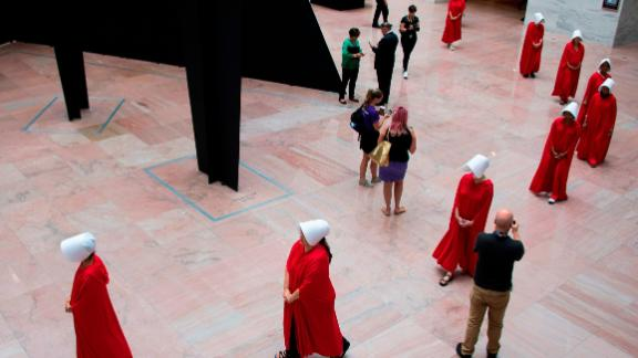 "Women dressed as characters from the novel-turned-TV series ""The Handmaid's Tale"" walk through the Hart Senate Office Building as Supreme Court nominee Brett Kavanaugh starts the first day of his confirmation hearing."