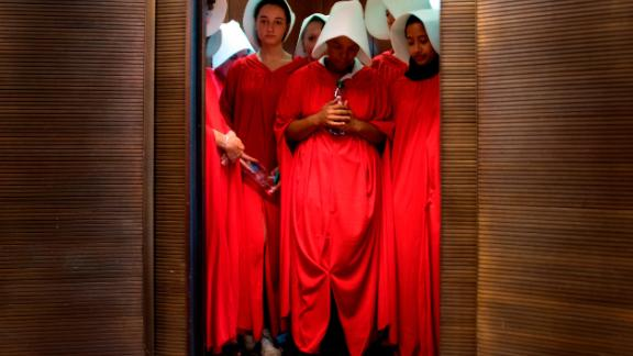 "Women dressed as characters from ""The Handmaid's Tale"" stand in an elevator at the Hart Senate Office Building as Supreme Court nominee Brett Kavanaugh starts the first day of his confirmation hearing."