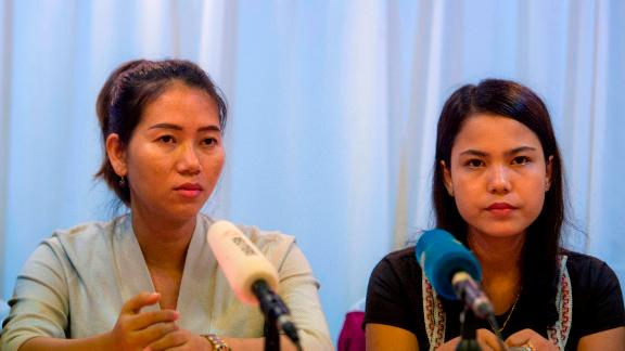 Pan Ei Mon (L) and Chit Su Win (R), wives of detained Reuters journalists Wa Lone and Kyaw Soe Oo, attend a press conference in Yangon on September 4, 2018. - A global outcry over the jailing of two Reuters journalists has been met with silence from Myanmar