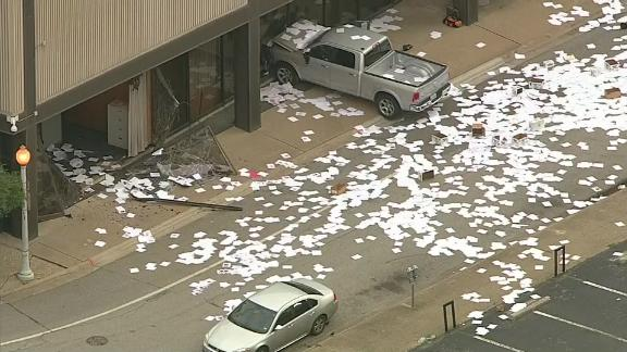 Footage shows papers strewn across the ground Wednesday after the truck smashed into the station.