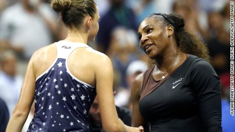 Williams and Pliskova shake hands following their match.