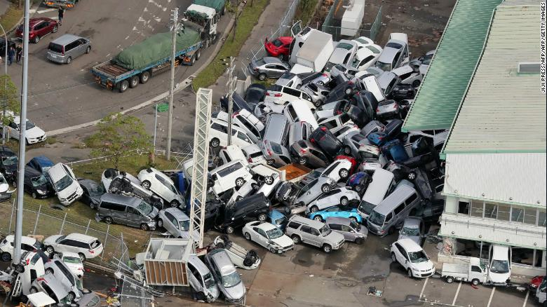 Strong winds in Kobe left cars piled in a heap.