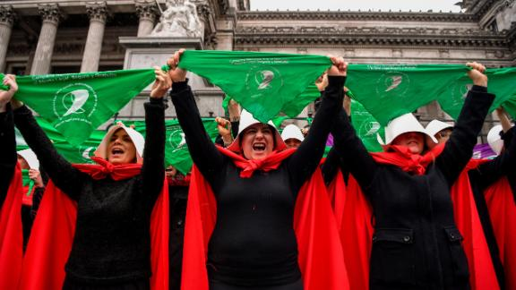 "Activists in favor of the legalization of abortion disguised as characters from ""The Handmaid's Tale"" display green headscarves as they perform outside the National Congress in Buenos Aires, Argentina, on July 25, 2018."