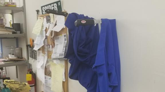 The suspected thieves left their uniforms pinned to a wall with knives.