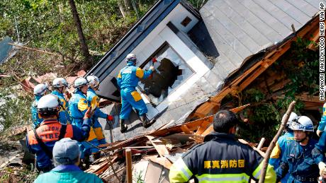 Police search for missing persons around a house destroyed by a landslide after a powerful earthquake in Atsuma town, Hokkaido, northern Japan.