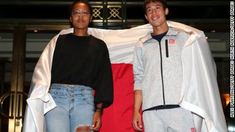 Men's singles semifinalist Kei Nishikori and women's singles semifinalist Naomi Osaka, both of Japan pose for a portrait following their quarterfinal matches on day 10 of the US Open.
