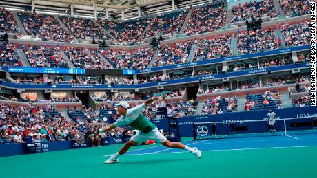Nishikori stretches for a return during his quarterfinal match against Marin Cilic.