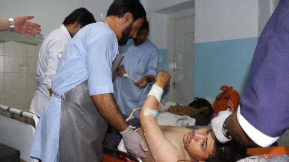 An Afghan victim receives medical treatment at a hospital following twin blasts in Kabul on September 5, 2018.